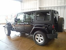 2014 Jeep Wrangler 4WD Unlimited Sahara for sale 100973052